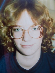 Bad perm and worse glasses